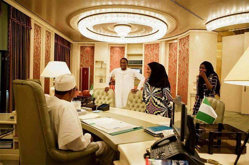 President Buhari pictured with his son Yusuf and daughters in office