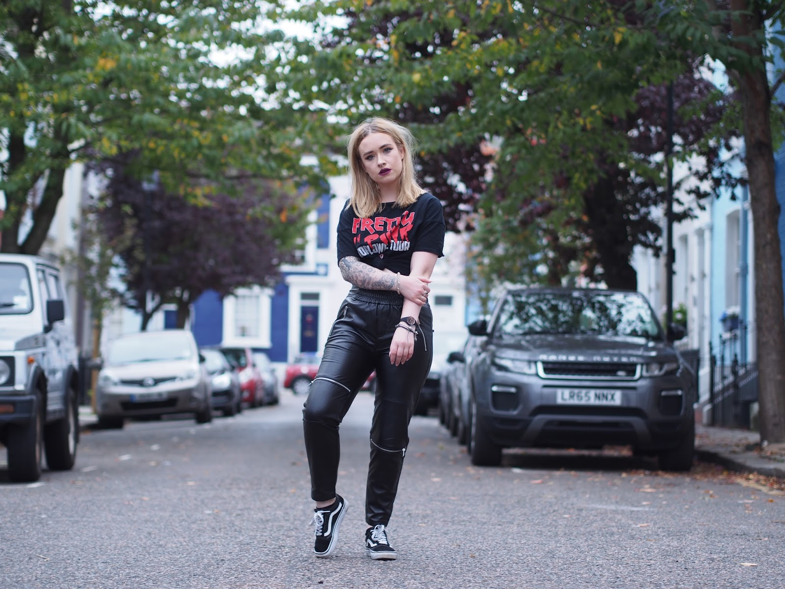 Fashion blogger Lucy Love styles faux leather pants