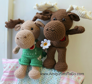 crochet moose wearing overalls