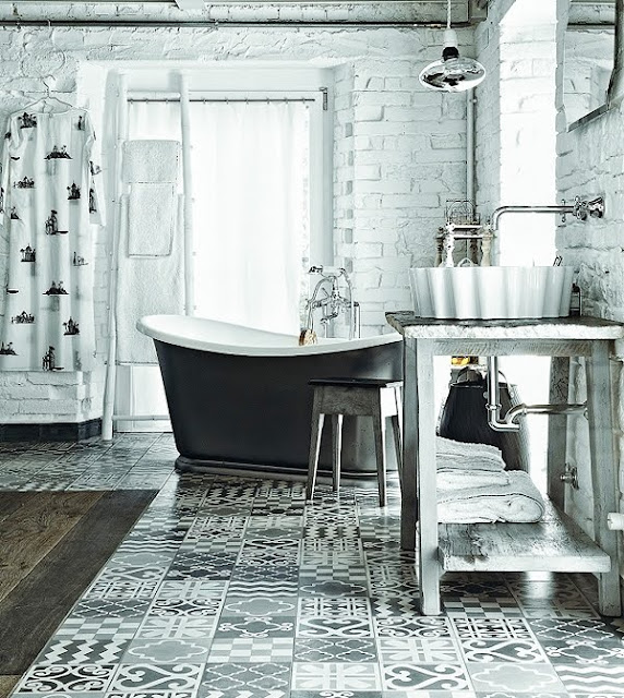 rustic white and grey bathroom with painted bricks