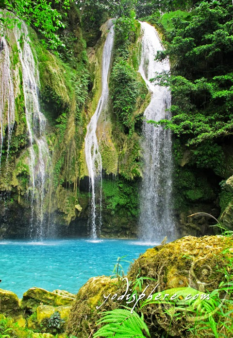 hover_share Like a secret paradise - Mag-aso Falls with its turquoise water and surrounding greenery.
