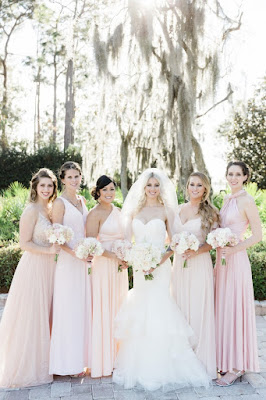 peach and pink bridesmaids with bride