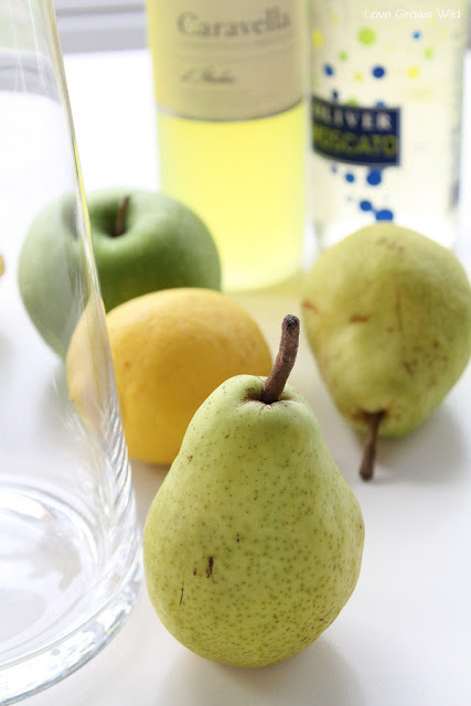 This Apple and Pear White Sangria is the PERFECT drink for fall! Sweet, fruity, and very refreshing! LoveGrowsWild.com