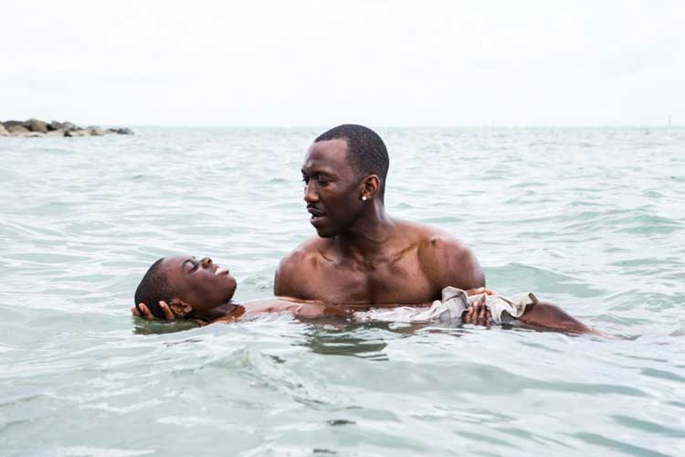 Mahershala Ali teaches a young boy to swim in Barry Jenkins' Moonlight.