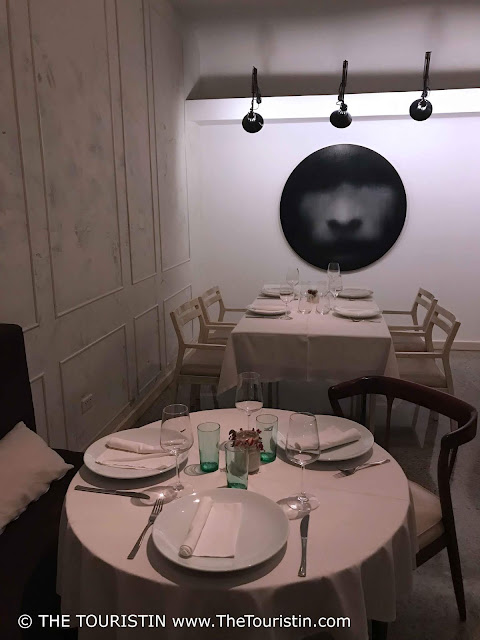 Set tables and art as background at restaurant Otramanera in Havana in Cuba