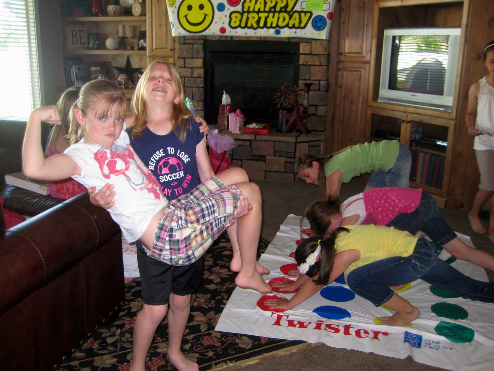 Little girls playing twister are