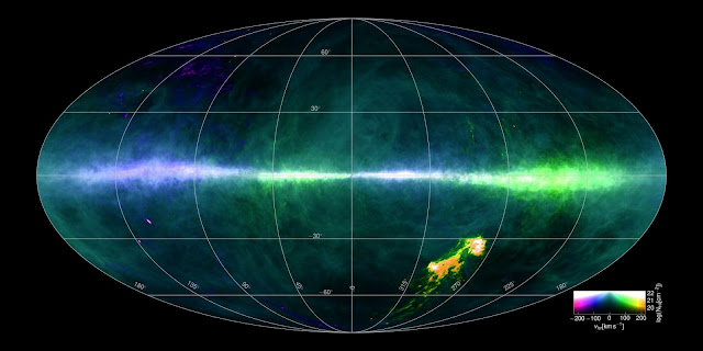 This HI4PI map was produced using data from the 100 metre Max-Planck radio telescope in Effelsberg, Germany and the 64 metre CSIRO radio telescope in Parkes, Australia. The image colours reflect gas at differing velocities. The plane of the Milky Way runs horizontally across the middle of the image. The Magellanic Clouds can be seen at the lower right. Image credit: Benjamin Winkel and the HI4PI collaboration.