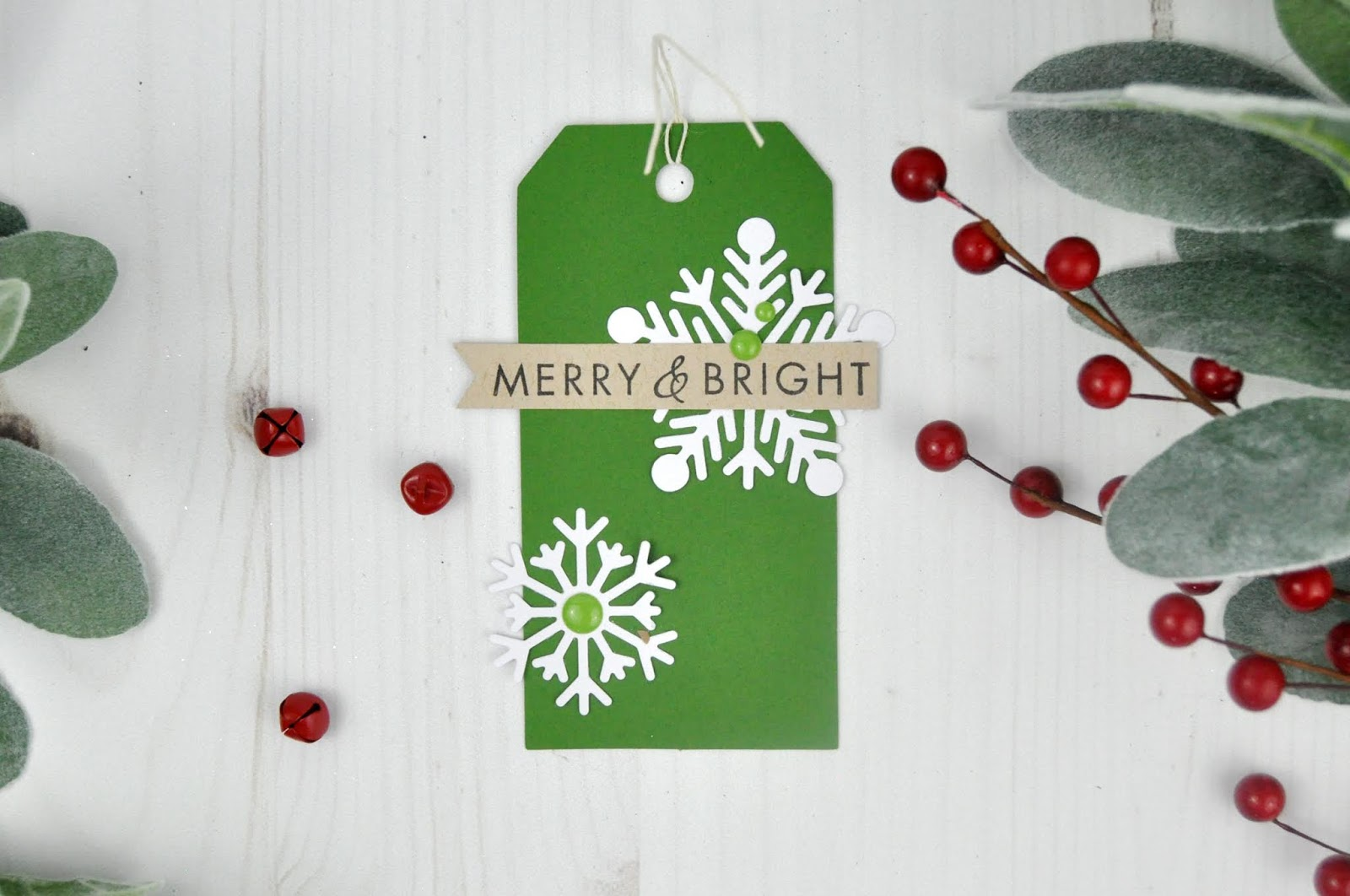 Christmas card and tags stamped and die cut with holiday phrases and Christmas die cut shapes. Created by Jen Gallacher for www.jengallacher.com. #christmascard #christmastag #diecutting #holidaytag #jengallacher