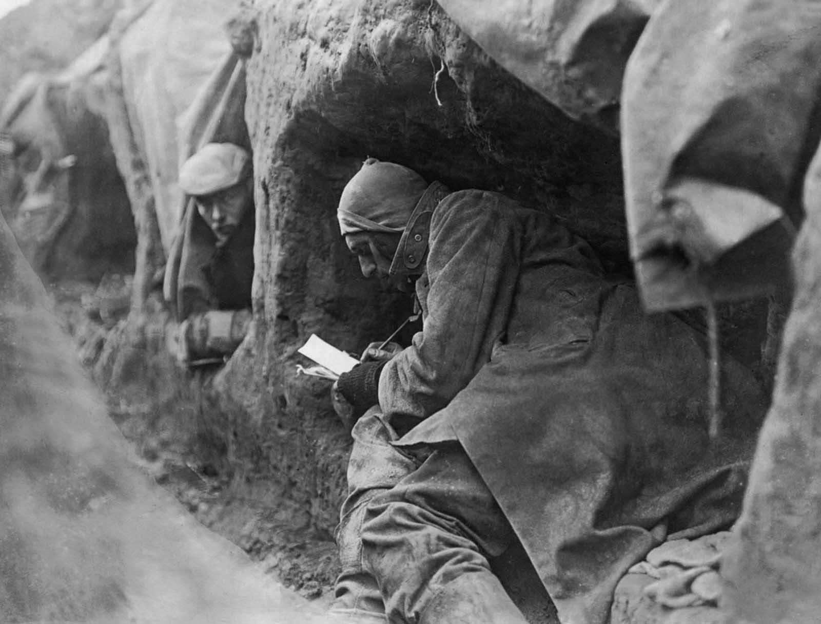 Soldiers in trenches during write letters home. Life in the trenches was summed up by the phrase which later became well-known: