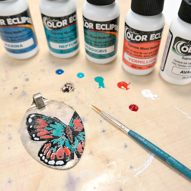 Metal Pendant with Orange, Teal, and White Painted Butterfly
