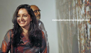 Manju Warrier and Big B in an advertisement