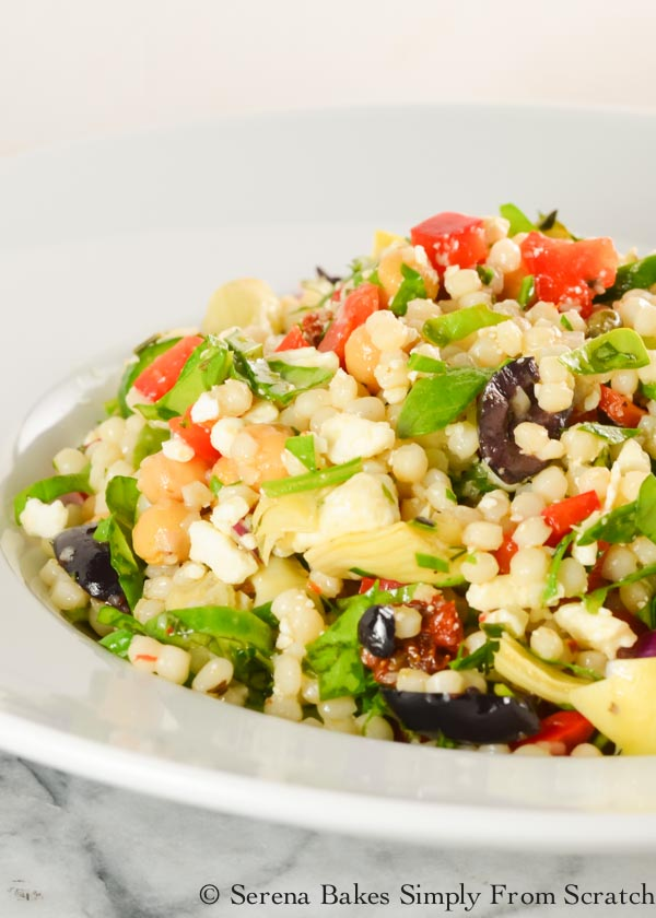 Mediterranean Couscous Pasta Salad is a simple side dish recipe or light dinner with fresh herbs, olives, artichokes, bell pepper, spinach, and lots of other goodies from Serena Bakes Simply From Scratch.