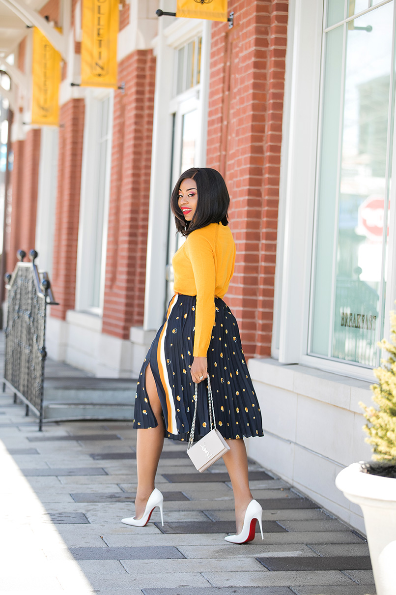 Stella-Adewunmi-of-jadore-fashion-shares-her-work-style-in-midi-pleated-skirt