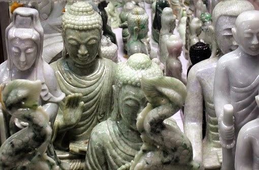 white and green sitting jade Buddha on sale in Yangon