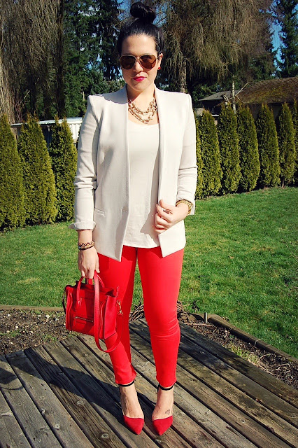 Helmut Lang gala knit blazer, gold aviator sunglasses, red Rockstar jeans and a red Celine Nano..