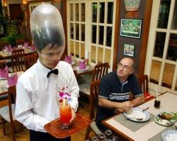 Waiter with a condom on his head