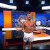 Gary Lineker presents match of the day in his underwear after promising to strip off if Leicester win the title (photos)