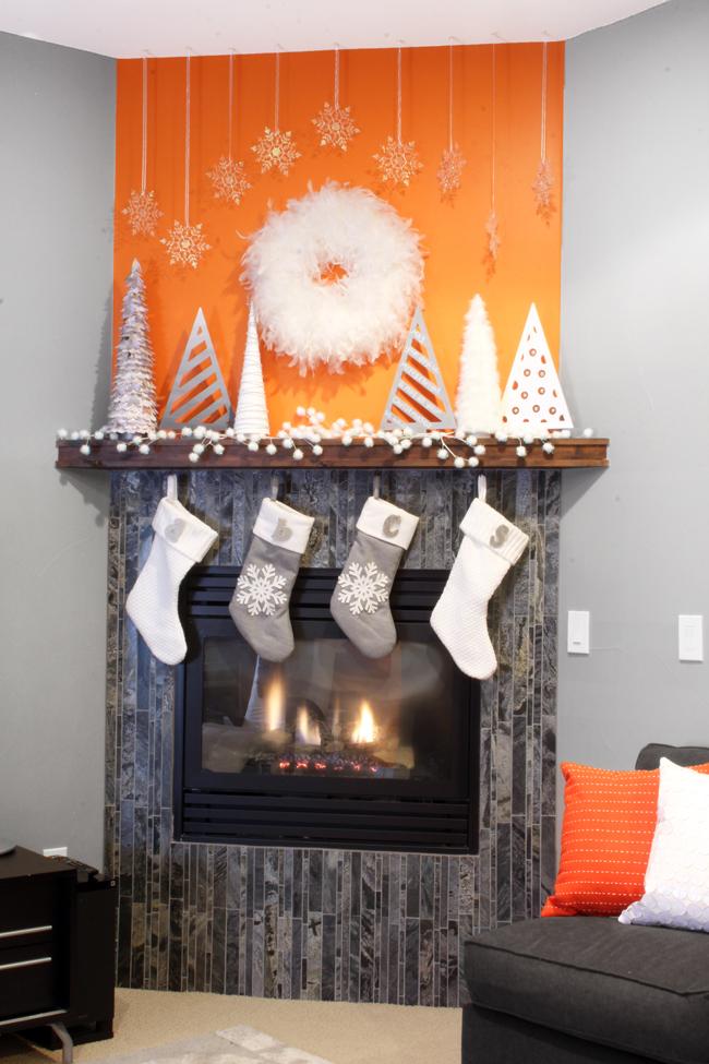 Glam and Modern White Christmas Mantel Display Orange Wall