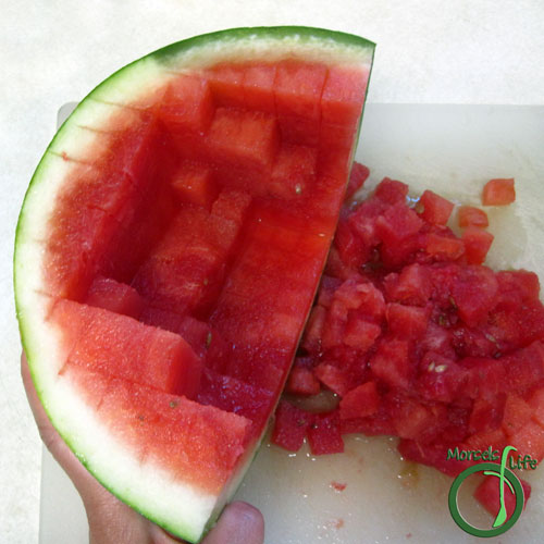 Morsels of Life - How to Cut a Watermelon Step 6 - Turn watermelon and slice in the remaining direction. Once you start cutting, the watermelon cubes should start separating.