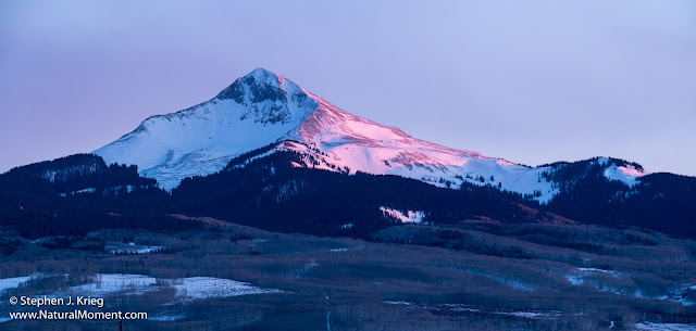 Alpenglow sunset on Lone Cone Peak, Colorado.