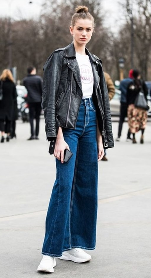 how to wear a pair of wide pants : leather jacket + white sneakers + t-shirt