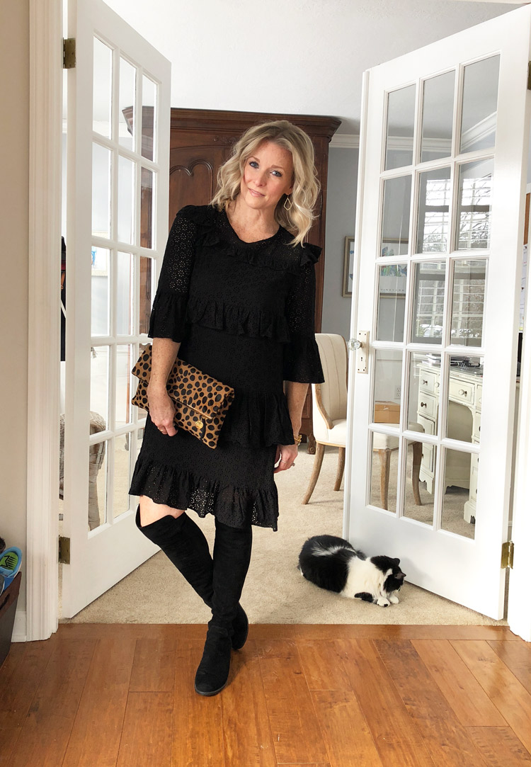 black lace dress with over the knee boots and leopard print clutch
