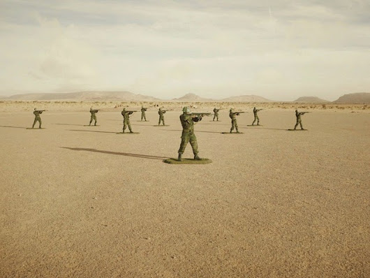 Photographer Poses Real Soldiers as Plastic Army Men in the Desert of Western Sahara