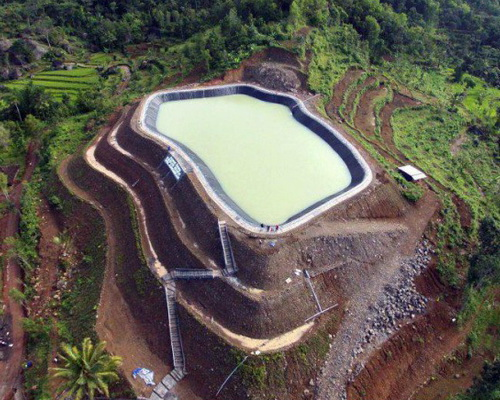 www.Tinuku.com Embung Nglanggeran geomembrane constructed to collect rainwater for agricultural water supply