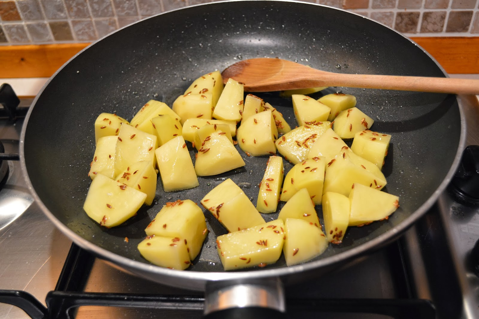 Frying the potatoes with cumin seeds