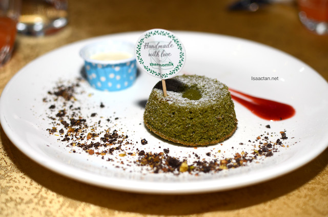 Green Tea Lava Cake Served With Ice Cream.