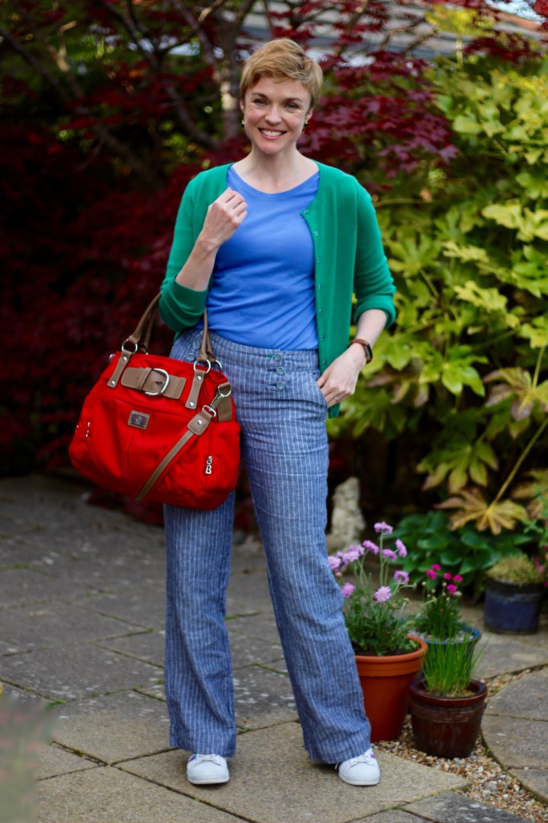 Blue sailor trousers, green boden cardigan, red bag & Superstars | Fake Fabulous