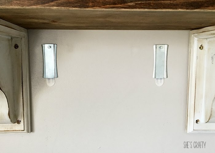 How to hang something without damaging a wall.  Command saw tooth hangers.