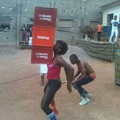 woman lifts crates of beer with her boobs in cameroon