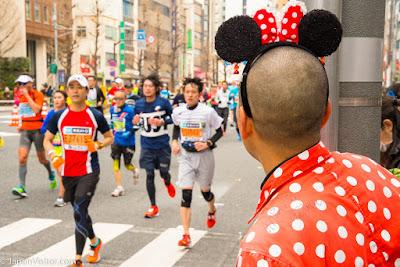 Mickey Mouse spectator and runners at the Tokyo Marathon 2018, Asakusabashi, Tokyo, Japan.