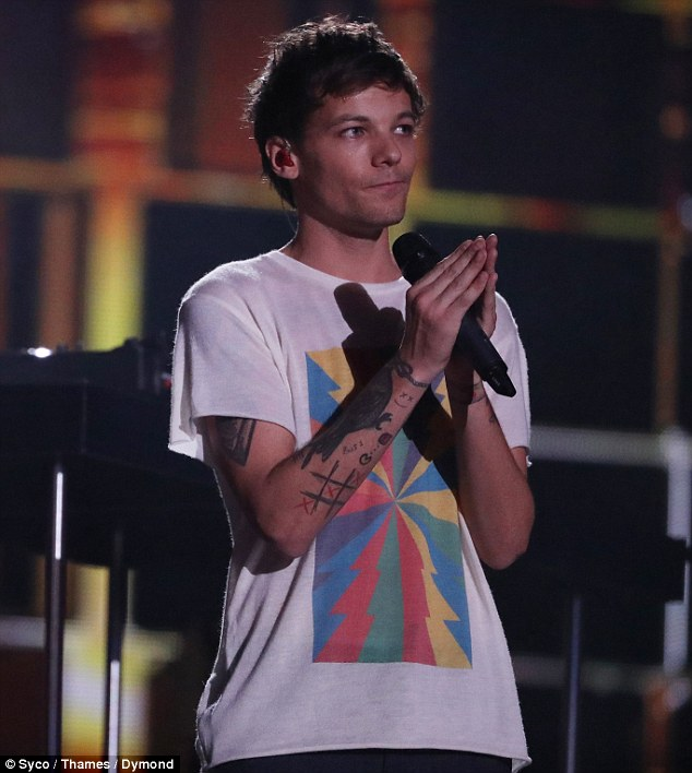 Louis Tomlinson's debut single tops UK iTunes chart after emotional X Factor performance,as singer grieves the death of his mother Johannah