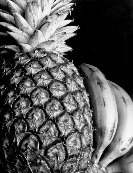 This photograph shows the evidence of contrast the smooth soft texture of bananas can be contrasted with the rough sharp texture of a pineapple