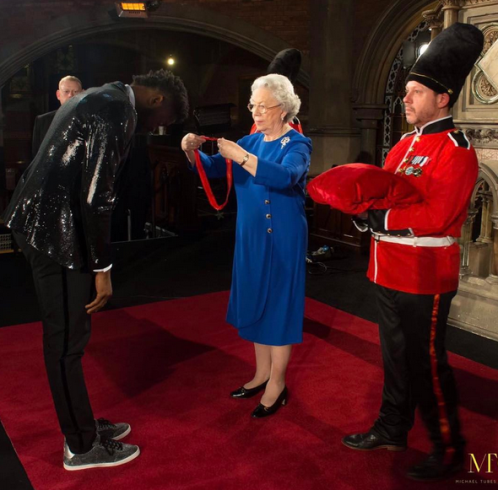 Basketmouth gets Knighted by the Queen of England