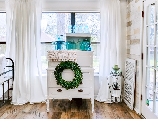 white cottage dresser with blue ball jars