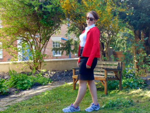 Red jacket, black mesh skirt, white shirt, trainers