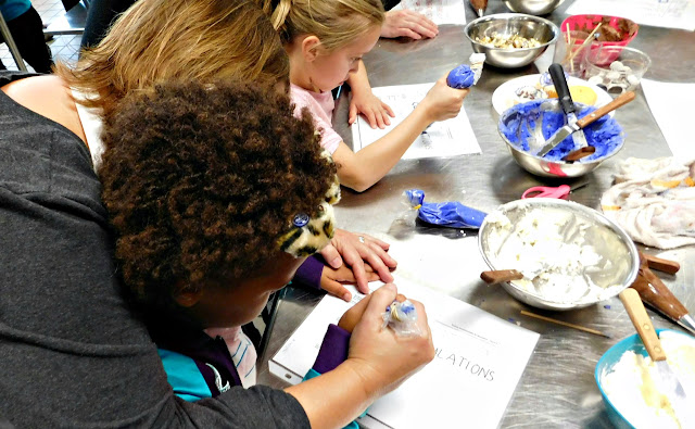 Learning to write with frosting with Girl Scouts of North East Ohio