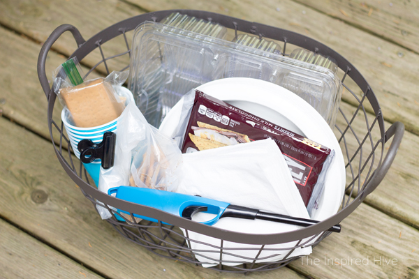 Party hosting tip! Hide a basket under the table for easy restocking of utensils, napkins, chips, crackers, etc.