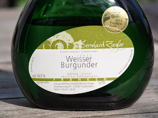 Label on a German wine bottle, here on a bottle called Bocksbeutel, which is the traditional Franconian shape of bottles.