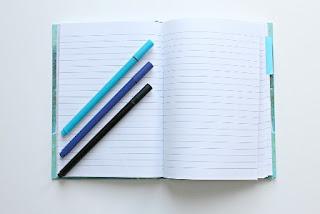 tema scritto su quaderno