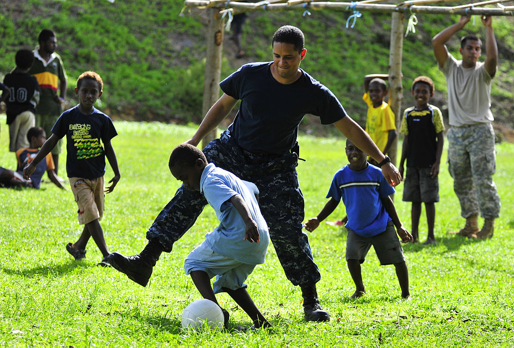 http://commons.wikimedia.org/wiki/File%3AUS_Navy_110430-N-KB563-145_A_Sailor_plays_soccer_with_local_children_during_a_community_service_project_at_Unity_Park.jpg