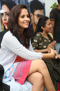Actress Anasuya Bharadwaj in Orange Short Dress Glam Pics at Winner Movie Press Meet February 2017 (14).JPG
