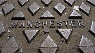 "Cast iron cover with the name ""Manchester"""