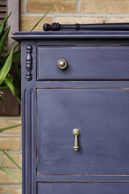 blue dresser with drop pulls