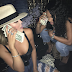 Khloe Kardashian and best friend Malika pose with stacks of dollar bills