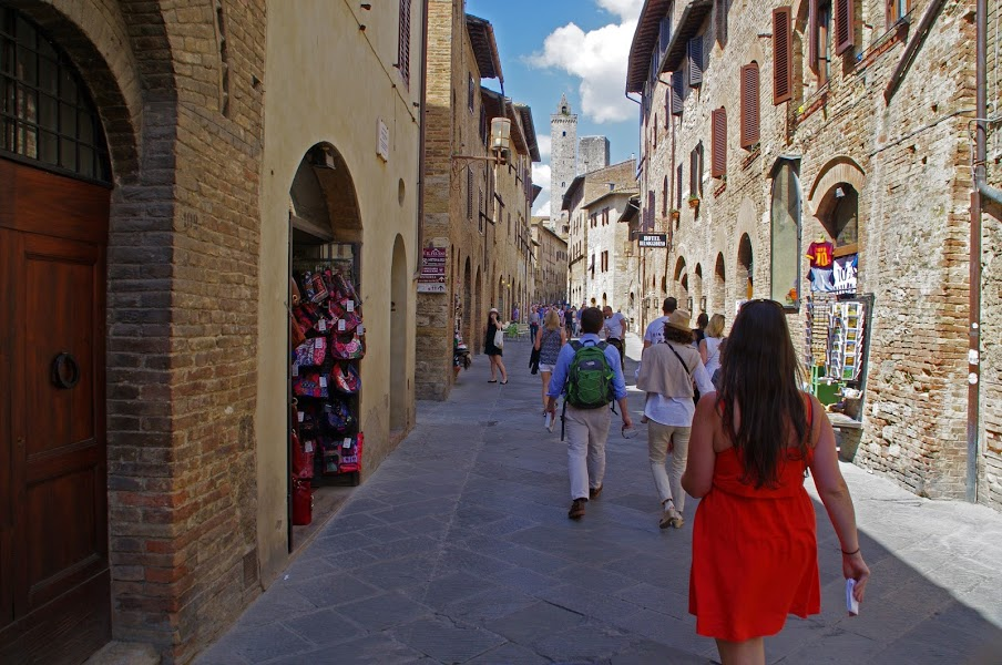Girl walking through streets of San Gimignano
