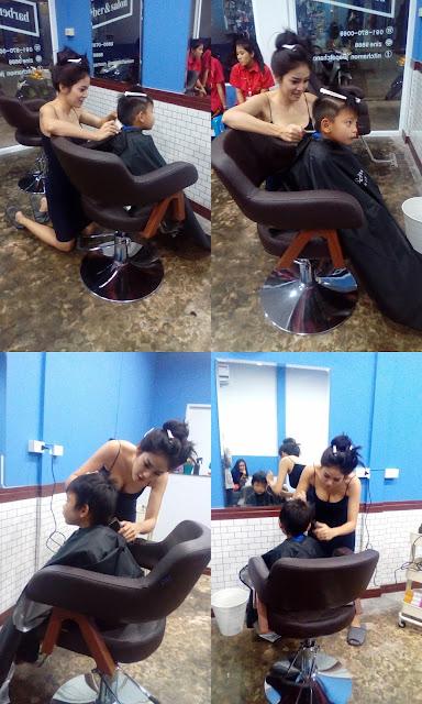 Nitchamon Jirapatchanon memangkas rambut anak-anak